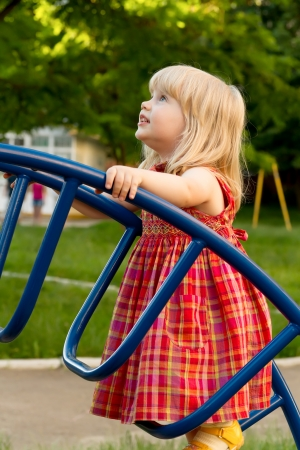 little blonde girl on the playground