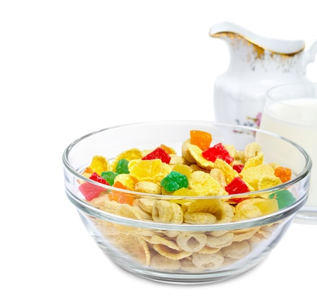 Healthy muesli with candied fruit in a bowl and a glass of milk isolated over white background