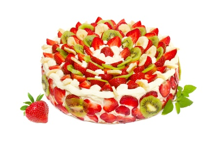 fruit cake with strawberries and kiwi fruit isolated on white