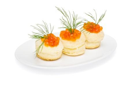 Tartlets with red caviar isolated on white photo