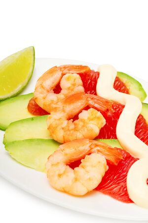 salad with shrimp, avocado and grapefruit isolated on white, focus on foreground