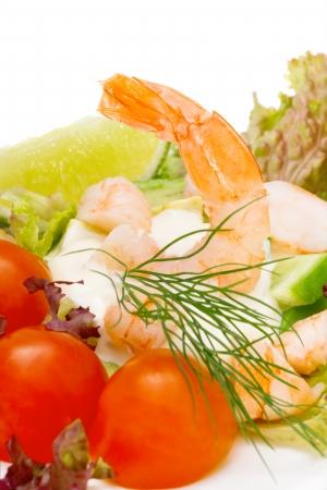 Healthy salad of shrimp, mixed greens and tomatoes.