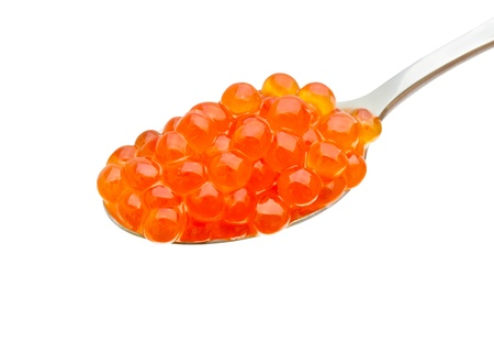 Red caviar in spoon isolated white background
