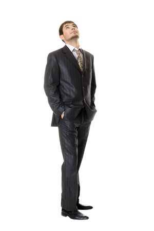 young businessman looking up  isolated on white photo