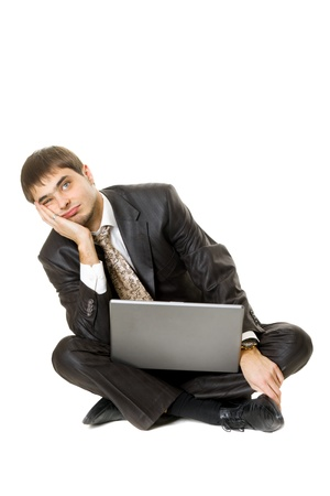 Young men with his laptop with a bored face isolated on white photo