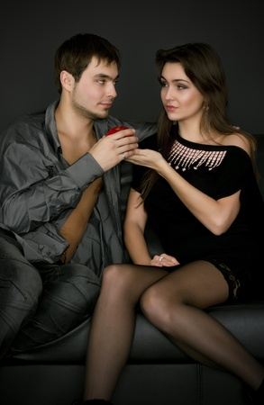 Young couple playing with apple Stock Photo