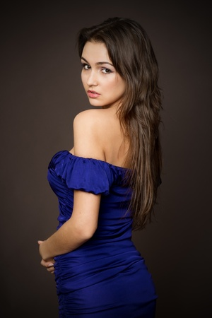 Attractive young fashion model posing in blue dress. Stock Photo