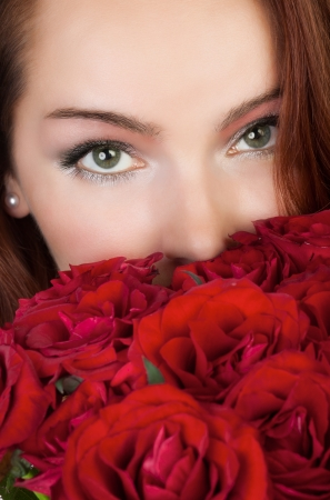 woman with a bouquet of red roses photo