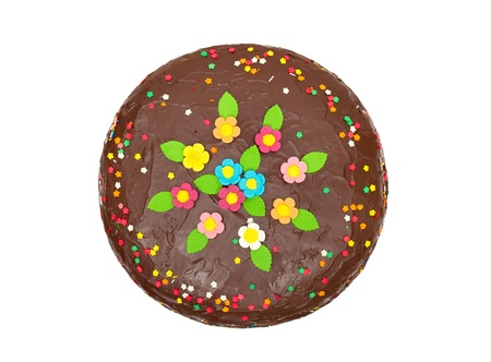 chocolate birthday colorful cake with flowers and confetti Stock Photo