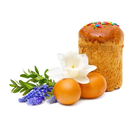 easter bread, eggs and spring flowers on white background