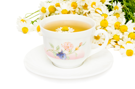 Herbal chamomile tea on a white background