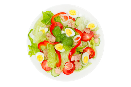 Tuna salad with lettuce, eggs and tomatoes isolated on white. Top view. 版權商用圖片