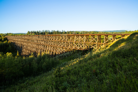 The historic railroad trestle in Pouce Coupe, near Dawson Creek, British Columbia. The trestle was built by the Northern Alberta Railway in 1931, but was abandoned after a quicker rail line was constructed. The trestle now sits as a tourist attraction for