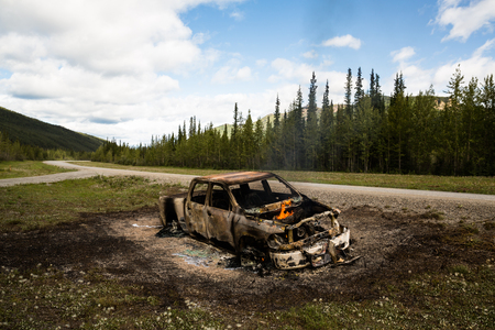 reportedly: Truck on fire off the side of the road far north in the wilderness of the Yukon Territory of Canada. The truck reportedly overheated late at night and was left on the side of the road after it erupted into flames. The driver made it out and no one was inj
