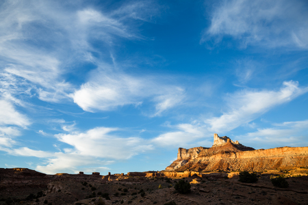 San Rafael Swell: Last light before sunset illuminates the steep cliffs of Temple Mountain. The peak is the highest point in the San Rafael Swell of Southern Utah. Many uranium mines were active in the early 1900s throughout the Swell.