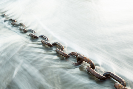 A large, rusty chain - weighing about 15-20 pounds per link - presumably left behind by an old shipwreck in the 1900s here on Second Beach, Washington. The chain has been greatly weathered by the tides over the years. For this exposure the shutter was le