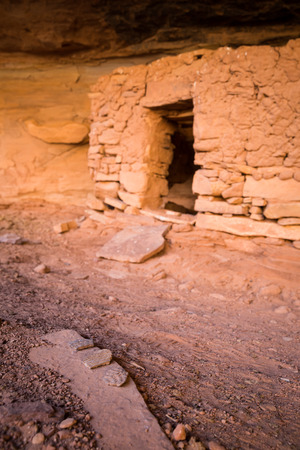 Three large potsherds (pot shards) rest on a sandstone rock near the entrance of an ancients Pueblo dwelling. The shards were left along with a pile of other artifacts near many dwellings like this one in the Southern Utah Desert.