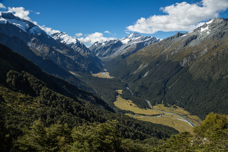 Looking up the steep glacial valley below the distant peak of Mount Aspiring from the trail to Cascade Saddle.