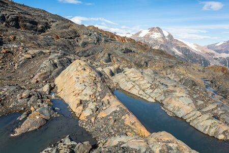 Glacial striations - abrasion of the bedrock by glaciers moving across it - newly exposed by melting glacier in the Boundary Range of Canada.