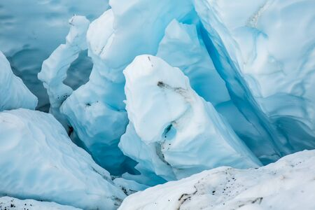 In an icefall of the Matanuska Glacier, deep in the Alaskan wilderness, several crevasses split the blue ice into tall unstable seracs ready to fall at any minute.
