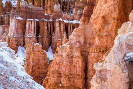 Fresh snow on red rock towers and cliffs of Bryce Canyon, Cedar Breaks, Southern Utah in winter.