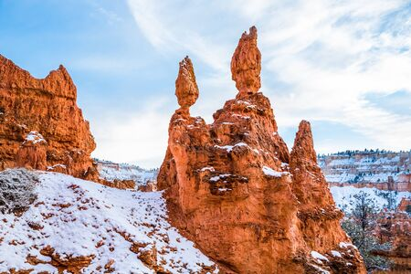 Red cliffs and towers of sandstone in Southern Utah Desert. Bryce Canyon, Cedar Breaks, Zion, slickrock with white snow. Фото со стока