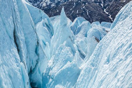 Looking down into an icefall of the Matanuska Glacier in Alaska. Broken ice, seracs and crevasses make travel through impossibly dangerous. Фото со стока