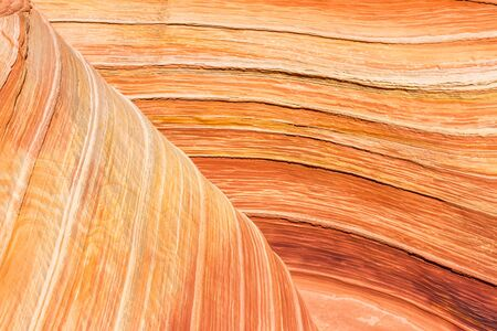 Orange, pink and red layers of striated sandstone in Arizona. Great graphic resource for real life natural lines and curves in actual stone. Фото со стока