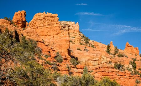 Towering cliffs of red and orange sandstone in Southern Utah desert near Bryce Canyon National Park. Фото со стока