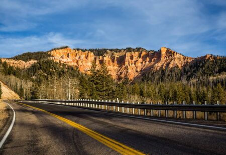 Scenic byway on Highway 14 through Cedar Canyon toward Cedar Breaks and Bryce Canyon National Park. Фото со стока