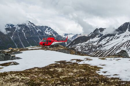Helicopter landed on the tundra in the remote backcountry in the Talkeetna Mountain Range. Helicopter access to Alaskan wilderness. Фото со стока