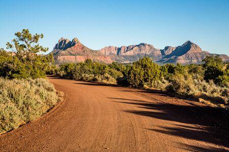 Dirt road cutting through the southern Utah desert in the popular Gooseberry Mesa Recreation Area.