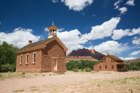 A ghost town school building and large house restored to original condition in a ghost town in Southern Utah. Фото со стока