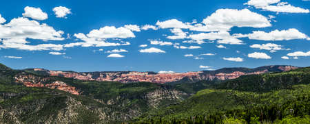 Cedar Breaks panorama composite of three images into high res wide shot of red rock cliffs.
