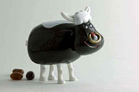 bull rings: Toy bull with poop.