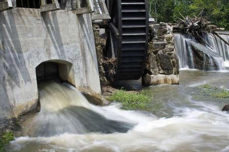 gristmill: Waterwheel on flooded Big Raccoon Creek in Bridgeston, Indiana Stock Photo