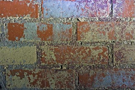 grundge: Brick wall close-up taken at night with highlights Stock Photo