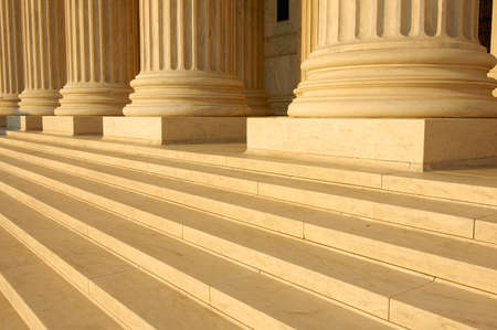 courthouse: Steps and columns on the portico of the United States Supreme Court in Washington, DC.
