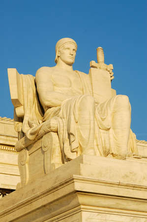 court proceedings: Authority of Law, Statue by James Earle Frasier at US Supreme Court Stock Photo