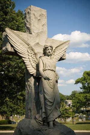 solemn: Solemn Female Angel on Cross Stock Photo