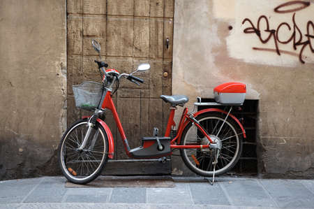Red Bicycle Parked on Sidewalk in Florence, Italy Stok Fotoğraf