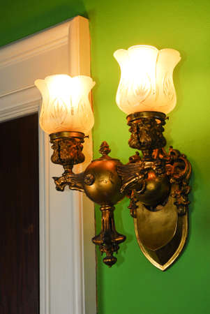 tarnish: Old light fixture in Victorian-era house.