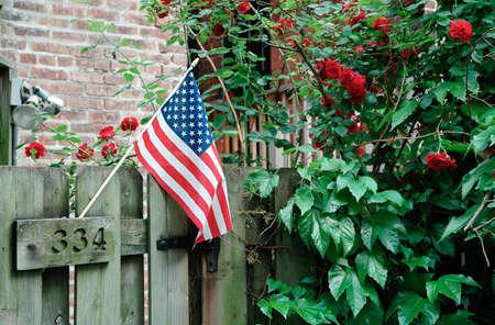 American flag in backyard garden