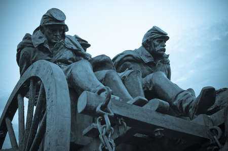 Civil war soldiers riding in wagon.