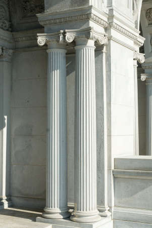 fluted: Pair of fluted classical columns at entrance of monumental building.