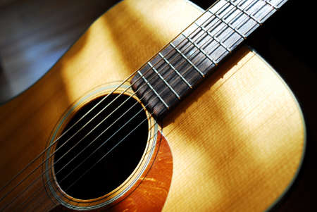 Detail of beatutiful acoustic guitar.