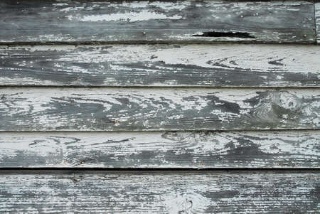 Weathered siding on old house  Symbolizes decay, age, and deterioration