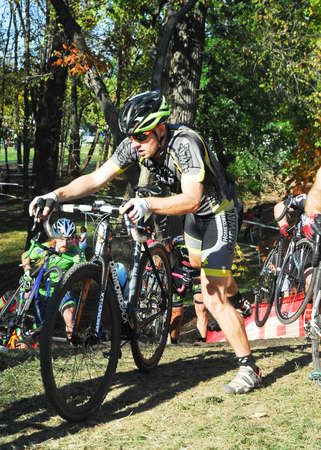 Louisville, Kentucky, Oct. 26, 2014 - Cyclists compete in the elite mens cyclocross race at Eva Bandman park.