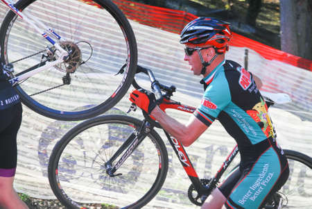 competes: Louisville, Kentucky, Oct. 26, 2014 - Cyclist competes in the elite mens cyclocross race at Eva Bandman park.