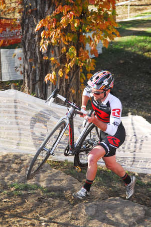 Louisville, Kentucky, Oct. 26, 2014 - Cyclist competes in the elite men's cyclocross race at Eva Bandman park.
